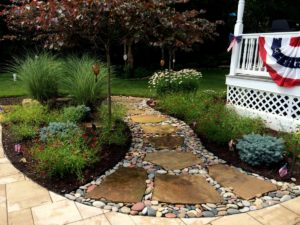 Step stone walkway in perennial garden.