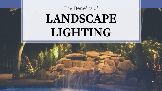 Outdoor landscape lighting around a waterfall next to the pool.  The Benefits of Landscape Lighting.